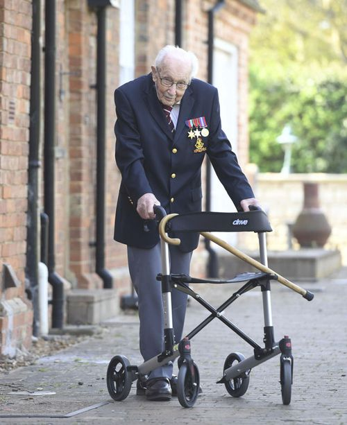 99-year-old war veteran Captain Tom Moore, poses for a photo at his home in Marston Moretaine, England, after he achieved his goal of 100 laps of his garden