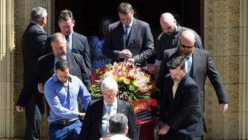 The coffin of Dreamworld accident victim Luke Dorsett is carried out of St Christopher's Cathedral in Canberra. (AAP)