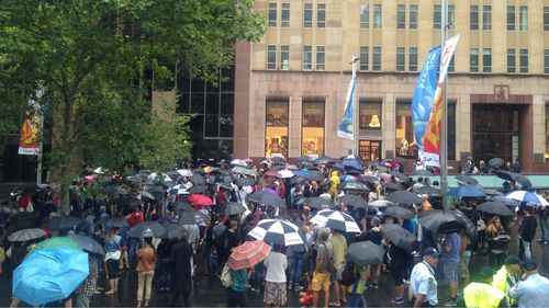 About 200 people attended a rally in Sydney's Martin Place in support of the Charlie Hebdo massacre victims. (9NEWS)