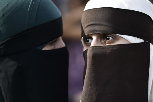 People demonstrate in Copenhagen last week against the new ban on garments covering the face. Picture: AP