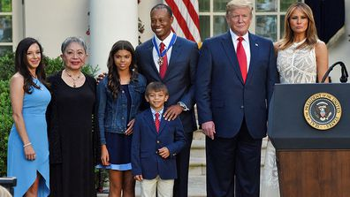 Tiger Woods with his family and Donald Trump