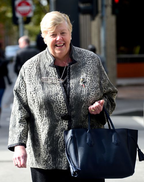 The post also referenced former Police Commissioner Christine Nixon, pictured here leaving court in 2016 after suing Mr Mullet over his claims she tried to ruin his career. (AAP)