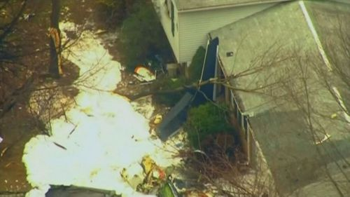 Six dead after private jet crashes into Washington home