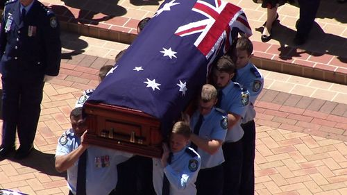 Constable Tim Proctor, 29, was killed in the smash in Sydney's Lucas Heights earlier this month was awarded two medals posthumously at the service, which brought Liverpool where he worked, to a standstill.