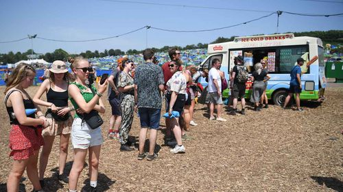 Britons queue up for an ice-cream at the Glastonbury festival.