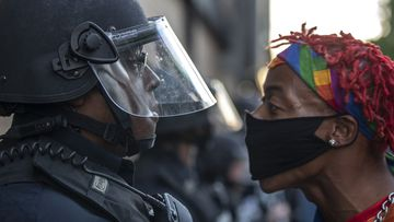 A protester confronts police during a rally in downtown Lexington, Kentucky, against the deaths of George Floyd and Breonna Taylor.