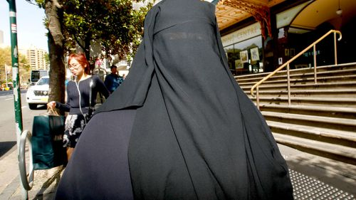 Moutia Elzahed leaves the Downing Centre district court, in Sydney. (AAP)