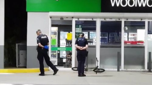 Police at the service station where the man rode for help.
