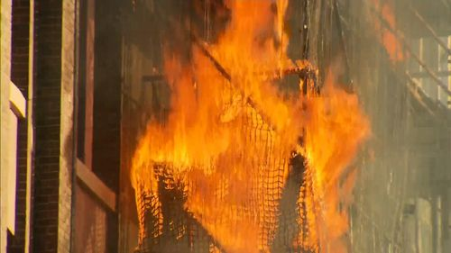 The destructive blaze has ripped through the scaffolding of  tower in Sydney's CBD. Picture: 9NEWS