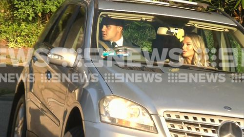 Walker and his fiancee leaving their Dee Why home this morning.