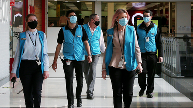 Members of the Broadway Shopping Centre team are seen wearing face masks on August 06, 2020 in Sydney, Australia.
