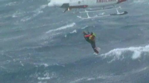 Davidson was dangled out of a helicopter to lift stranded crew from the ocean.