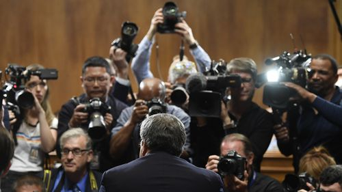 An intense media scrum greeted Barr.