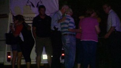 Neighbours gather in shock. (9NEWS)