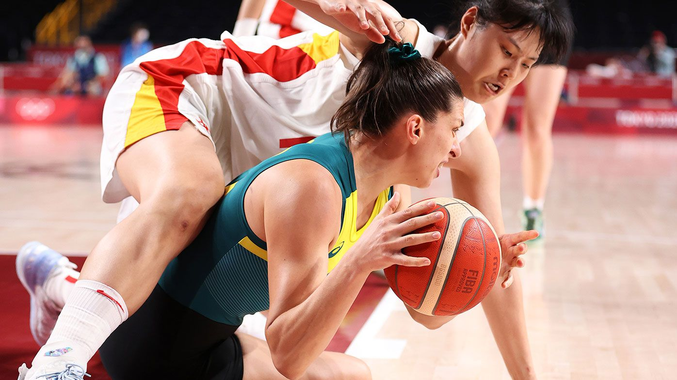 Yueru Li of Team China and Marianna Tolo of Team Australia fight for possession of the ball during the second half of a Women's Basketball Preliminary Round Group match between Australia and Puerto Rico at the Tokyo Olympics.
