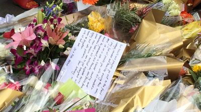 Notes and flowers left near the scene of the Lindt Cafe siege. (Supplied)