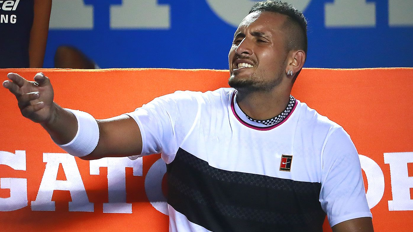Nick Kyrgios involved in a heated exchange with chair umpire in fiery win over Wawrinka
