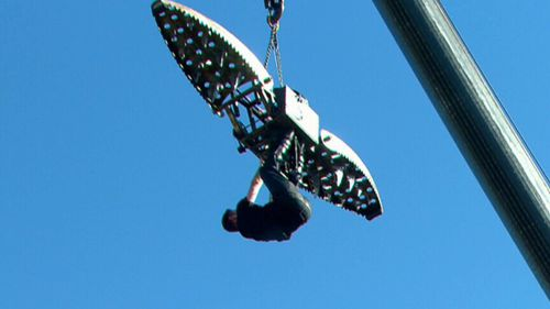 Powers was dangling high above the ground at Channel Nine's Sydney studio. (9NEWS)