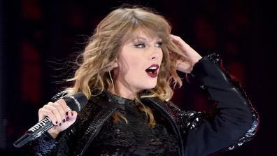 Taylor Swift, performing, on stage, singing
