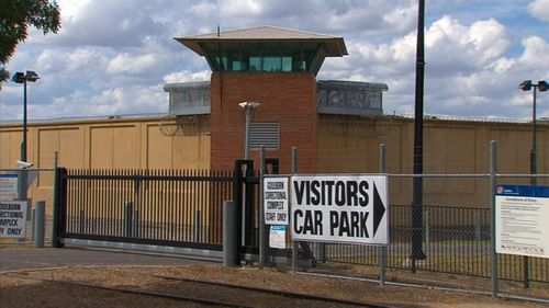 A young Indigenous inmate radicalised while behind bars has been charged with smuggling a mobile phone into prison, allegedly downloading extremist videos and a dating app.