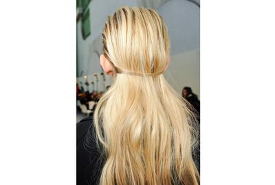 <p>At Guy Laroche, two pieces from the front of the hair were pulled back to create a band, with the remaining hair cascading beneath. This is a great solution for rainy days when you want to wear your hair out.</p>