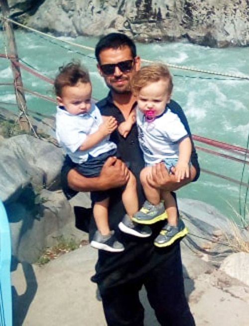 Mr Wangkimshen, pictured with his twin sons, Imran and Ibrahim.