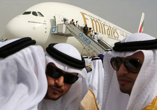 Emirati officials greet each other in front of an Emirates Airbus A380 on display during the opening day of the Dubai Airshow in Dubai, United Arab Emirates. (AAP)