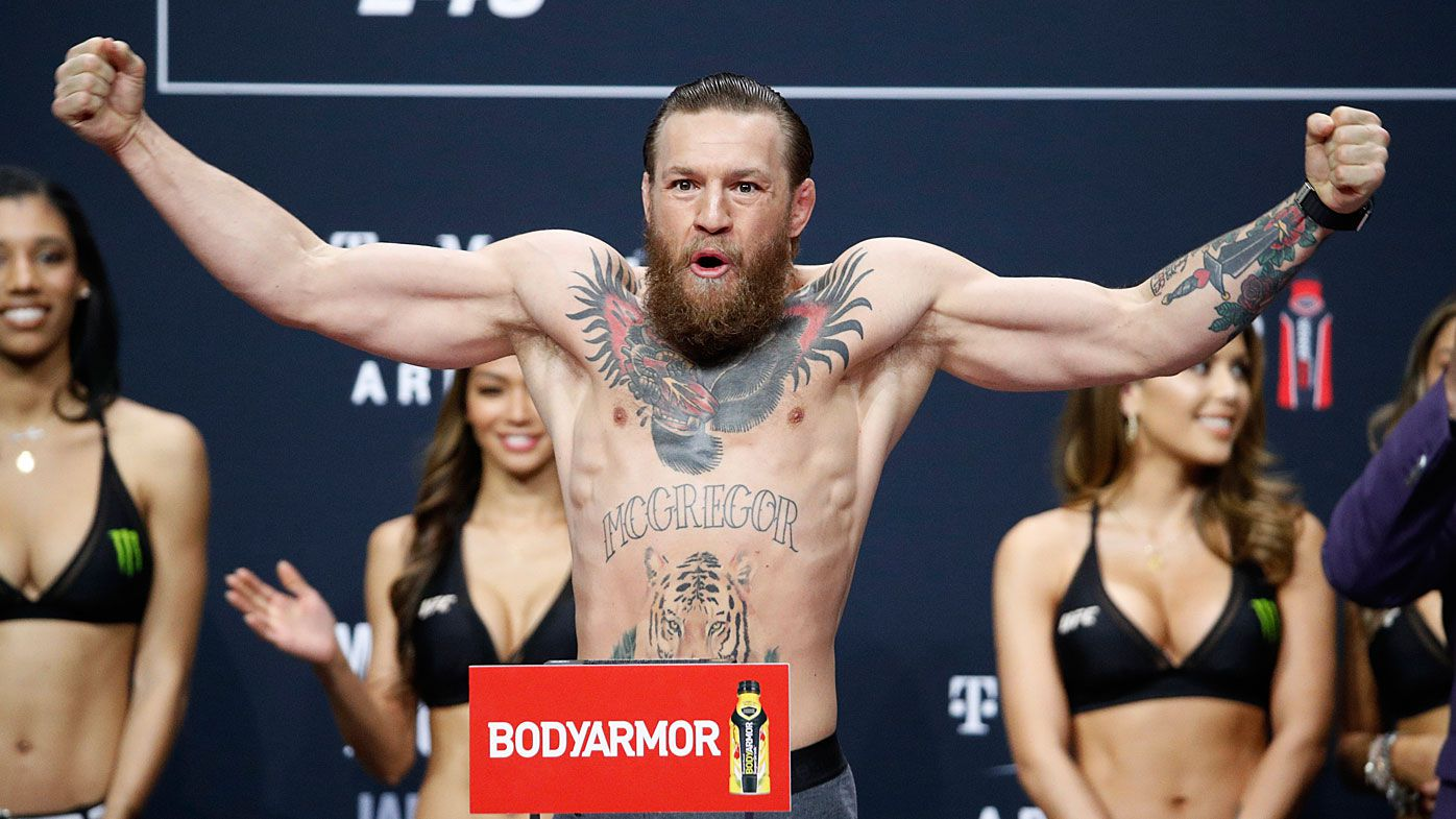 Conor McGregor poses during the weigh-in for the UFC 246