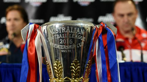Eyes on the prize: the 2016 AFL premiership cup. (AAP)