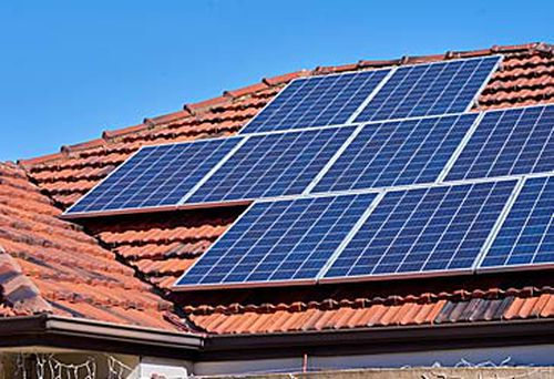 Solar panels on top of house (Getty)