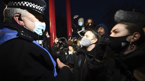 People react with police, in Clapham Common as people gather, despite the Reclaim These Streets vigil for Sarah Everard being officially cancelled.