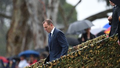 Former Prime Minister Tony Abbott arrives at the Australian War Memorial where Britain's Prince Charles and his wife Camilla, the Duchess of Cornwall, are also in attendance. (AAP)