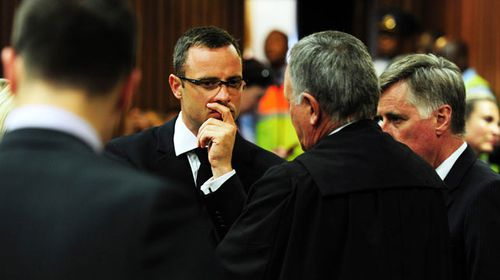 South African Paralympic athlete Oscar Pistorius listens to his lawyer Barry Roux on the thirteenth day of his trial for the murder of his girlfriend Reeva Steenkamp. (Getty)
