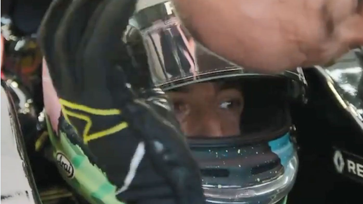 Daniel Ricciardo rubs the head of his mechanic