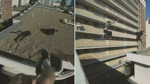 The potentially fatal stunt shows four young men on a Gold Coast rooftop leaping between high rises without a safety net. Picture: 9NEWS
