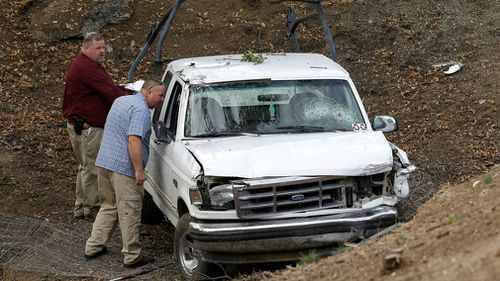 Investigators view a pickup truck involved in a deadly shooting at the Rancho Tehama Reserve, near Corning, California. (AAP)