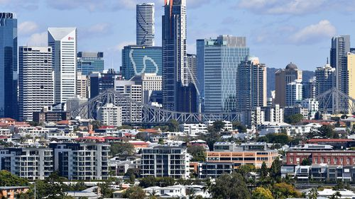 Houses and apartment buildings are seen against the Brisbane CBD skyline in Brisbane.