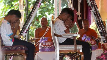 Members of the rescued soccer team attend a Buddhist ceremony that is believed to extend the lives of its attendees as well as ridding them of dangers and misfortunes in Mae Sai district, Chiang Rai province, northern Thailand. (Image: AP)