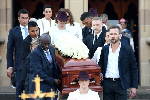 Pallbearers carry the casket of Les Murray following his State Funeral at St Mary's Cathedral. (AAP)