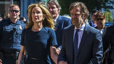 Felicity Huffman arrives with her husband William H. Macy at John Joseph Moakley US Courthouse in Boston on Sept. 13, 2019. She gets 14 days jail for her role in the college admissions scandal
