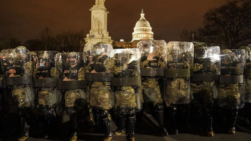 DC National Guard stand outside the Capitol.