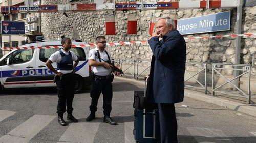 A passenger waits outside Marseille's main train station. (AP)