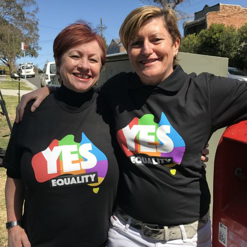 """Liberal Party Councillor (And sister of Tony Abbott) Christine Forster and Partner Virginia Edwards, standing near a letterbox while attending a Same Sex Marriage """"Yes"""" campaign event in Sydney."""