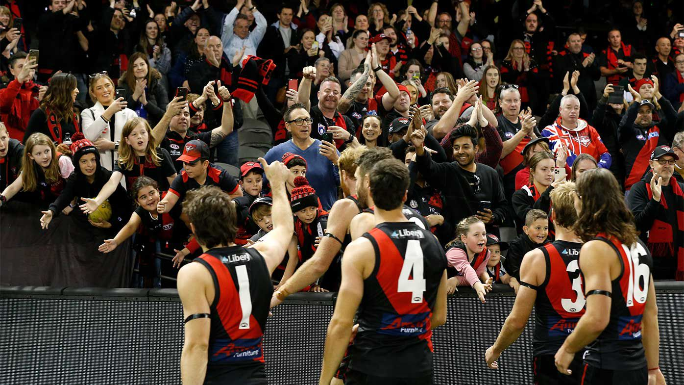 Essendon players acknowledges their fans after the round 10 AFL match between the Essendon Bombers and the North Melbourne Kangaroos at Marvel Stadium.