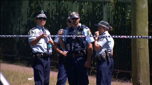 A police officer was doused with petrol at the scene. (9NEWS)