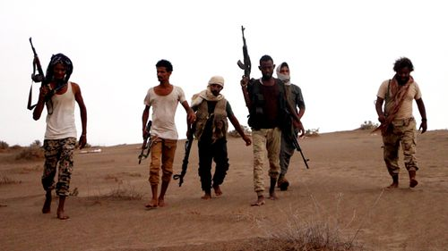 Soldiers of Yemeni government army backed by the Saudi-led coalition take position during military operations on Houthi positions in the port province of Hodeidah, Yemen. (AAP)
