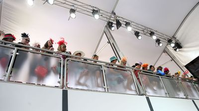 Spectators watch the Myer Fashions on the Field. (Getty)