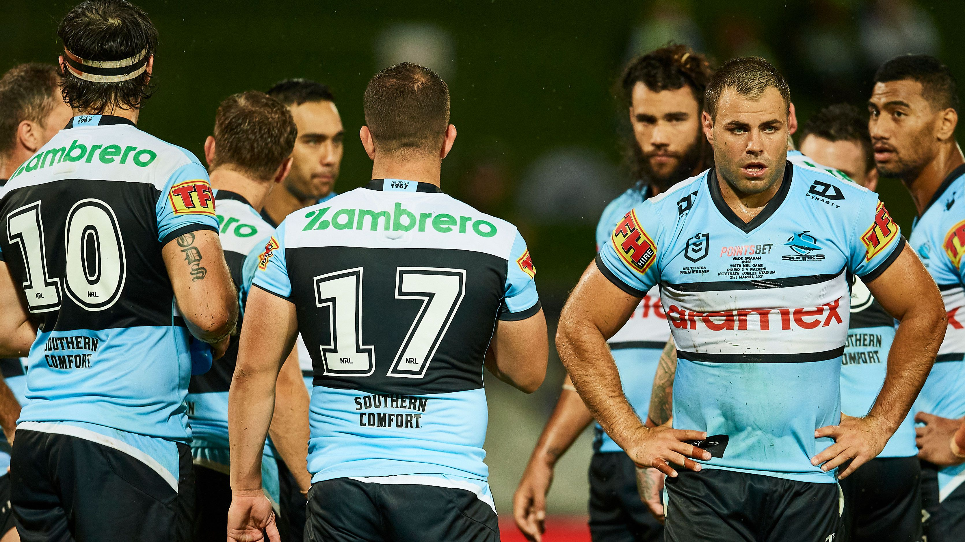 Cronulla Sharks players gather during their clash with the Raiders.
