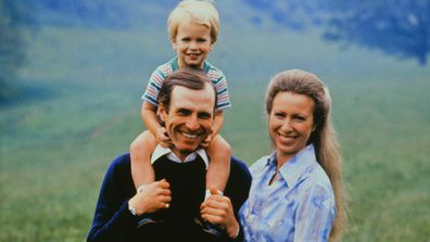 Princess Royal Princess Anne with husband, Mark Phillips carries their son, Peter, on his shoulder in July 1980
