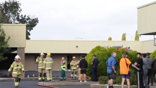 Emergency services gather outside a motel in South Australia after a blaze erupted in one of the rooms.